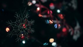 Christmas handmade decoration a wooden snowflake. Christmas handmade decoration wooden snowflake. Lights flash stock video footage