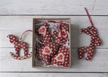 Christmas handmade decorations soft toys. In gift box flat lay top view stock images