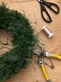 Christmas handmade diy background. Making craft xmas wreath. Top view of wooden table. Things to diy Christmas wreaths. Christmas. Things to manufacture stock photography