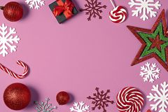 Christmas handmade gift boxes decorated with candy, star, white snowflakes on pink background top view. stock image