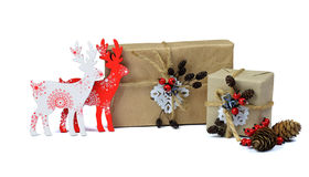 Christmas handmade gifts. Wooden deer. Rustic style. / Isolated. Christmas composition with present boxes, red berries, deer and Stock Photos