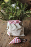 Christmas handmade heart shaped decoration and pines in bag Royalty Free Stock Photography