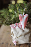 Christmas handmade heart shaped decoration and pines in bag Stock Image