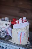 Christmas handmade heart shaped decorations in linen bag Stock Image
