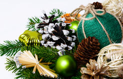 Christmas handmade ornaments and snowy decorated pine cones Royalty Free Stock Photo