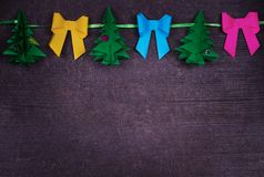 Christmas handmade paper decoration on old wooden shabby background Royalty Free Stock Images