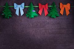 Christmas handmade paper decoration on old wooden shabby background Royalty Free Stock Photo