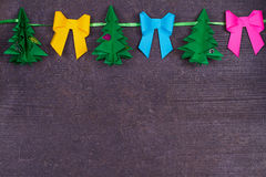 Christmas handmade paper decoration on old wooden shabby background. Close up. View from above, top shot Stock Image