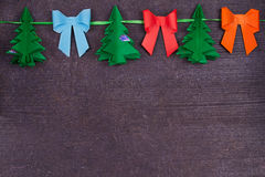 Christmas handmade paper decoration on old wooden shabby background. Close up. View from above, top shot. Stock Photography