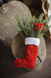 Christmas handmade red sock with pines and bow Royalty Free Stock Photo