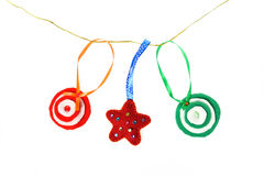 Christmas handmade toys. Garland of Christmas handmade toys. Handmade Christmas decorations made. of felt hanging on a rope stock photo
