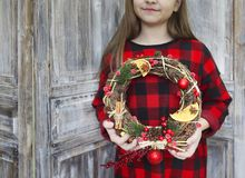 Christmas wreath in young womans hands. Christmas handmade wreath in young womans hands. Winter holidays celebration concept stock photography