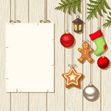 Christmas hanging decorations and a placard on a wooden background. Vector illustration. Vector Christmas hanging balls, socks, gingerbread cookies, fir-tree vector illustration