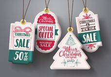 Christmas hanging sale tags vector set in white color with different shapes. And greetings and discount text for christmas holiday marketing promotions. Vector Royalty Free Stock Photos