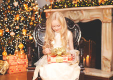 Christmas happy child little girl with gift box home Stock Images