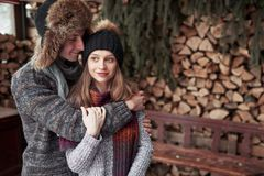 Christmas happy couple in love embrace in snowy winter cold forest, copy space, new year party celebration, holiday and. Vacation, travel, love and relations Royalty Free Stock Image