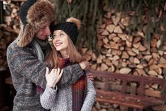 Christmas happy couple in love embrace in snowy winter cold forest, copy space, new year party celebration, holiday and. Vacation, travel, love and relations Stock Photo