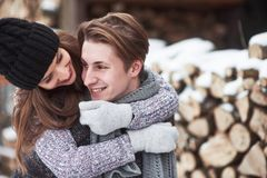 Christmas happy couple in love embrace in snowy winter cold forest, copy space, new year party celebration, holiday and. Vacation, travel, love and relations Royalty Free Stock Photography