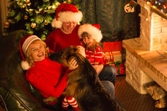 Christmas happy family of parents, kid and dog. Christmas happy family of parents, child and dog Royalty Free Stock Photo