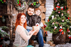 Christmas happy family of three persons and fir tree with gift boxes new year winter decorated background Stock Photos