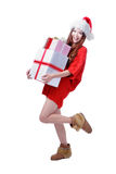 Christmas happy Girl Smile. Holding Gift Box, Model is a cute Asian beauty,  isolated on white background Royalty Free Stock Images