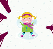 Christmas: Happy girl in snow making angel Stock Photos