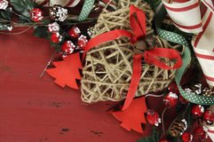 Christmas and Happy Holiday background on dark red vintage recycled wood - closeup. Royalty Free Stock Photos