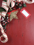 Christmas and Happy Holiday background on dark red vintage recycled wood Royalty Free Stock Photos