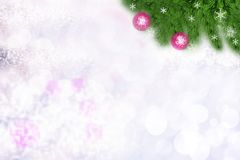 Christmas or Happy New Year background. Abstract blurred christmas or Happy New Year background with snow and red christmas balls royalty free stock photo