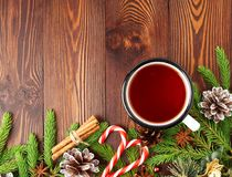 Christmas and Happy New Year background with tea. Top view, copy space. Fir branches, brown dark wooden table. Christmas and Happy New Year background with tea Stock Images