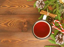 Christmas and Happy New Year background with tea. Top view, copy space. Fir branches, brown dark wooden table. Christmas and Happy New Year background with tea royalty free stock images