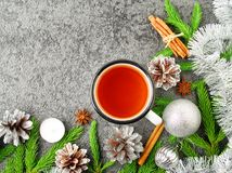 Christmas and Happy New Year background with tea. Top view, copy space. Fir branches, silver concrete. Christmas and Happy New Year background with tea. Top view Royalty Free Stock Photos