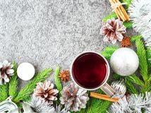 Christmas and Happy New Year background with tea. Top view, copy space. Fir branches, a silver concrete. Christmas and Happy New Year background with tea. Top Stock Images