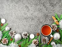 Christmas and Happy New Year background with tea. Top view, copy space, military stile. Fir branches, silver concrete. Christmas and Happy New Year background royalty free stock image