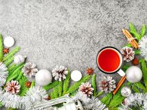 Christmas and Happy New Year background with tea. Top view, copy. Space, military stile. Fir branches, silver concrete Royalty Free Stock Photography