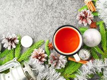 Christmas and Happy New Year background with tea. Top view, copy space, military stile. Fir branches, silver concrete. Christmas and Happy New Year background Royalty Free Stock Photo