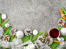 Christmas and Happy New Year background with tea. Top view, copy space, military stile. Fir branches, silver concrete. Christmas and Happy New Year background royalty free stock photography