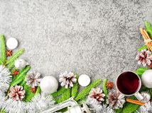 Christmas and Happy New Year background with tea. Top view, copy. Space, military stile. Fir branches, a silver concrete Stock Photo