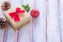 Christmas and happy new year brown gift box and red ribbon with. Tag on wood background. Top view with space for use Stock Image