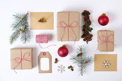 Christmas happy new year composition. Christmas gifts,pine branch, red balls, envelope, white wood snowflakes, ribbon, red berries. Christmas frame composition Royalty Free Stock Photo