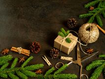 Christmas and Happy New Year dark brown background. Gift Christmas box, fir branches, top view, copy space. Christmas and the Happy New Year dark brown Royalty Free Stock Photography