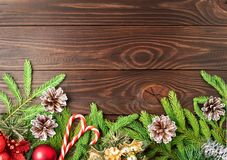 Christmas and Happy New Year dark brown background. Top view, copy space, wooden rustic table, fir branches stock image