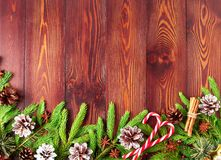 Christmas and Happy New Year dark brown background. Top view, copy space, wooden rustic table, fir branches. Christmas and Happy New Year dark brown background Stock Photo