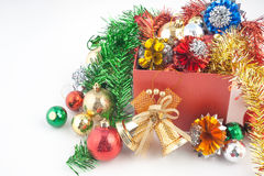 Christmas and Happy New Year gift box with decorations and color ball isolated on white background Stock Images