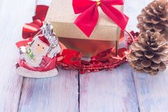 Christmas and happy new year gift box and red ribbon with tag on. Christmas and happy new year brown gift box and red ribbon with tag on wood background. Top Stock Photos