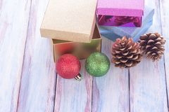 Christmas and happy new year gift box and red ribbon with tag on. Wood background. Top view with space for use Stock Photos