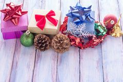 Christmas and happy new year gift box and red ribbon with tag on. Wood background. Top view with space for use Stock Images
