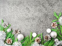 Christmas and Happy New Year gray stone background. Top view, copy space, military stile. Fir branches, silver concrete. Christmas and Happy New Year gray stone Royalty Free Stock Photography