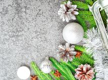 Christmas and Happy New Year gray stone background. Top view, copy space, military stile. Fir branches, silver concrete. Christmas and Happy New Year gray stone Stock Images