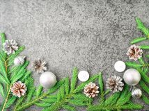 Christmas and Happy New Year gray stone background. Top view, copy space, military stile. Fir branches, silver concrete royalty free stock photo